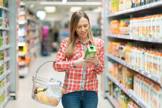young woman shopping groceries - ingredient stock pictures, royalty-free photos & images