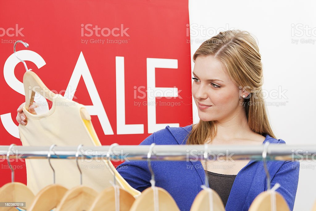 Young Woman Shopping in a Retail Fashion Sale royalty-free stock photo