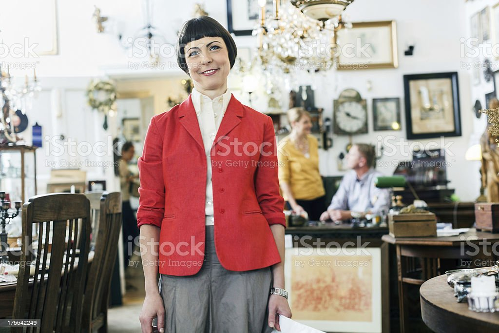 Young woman shopping in Antique Shop stock photo