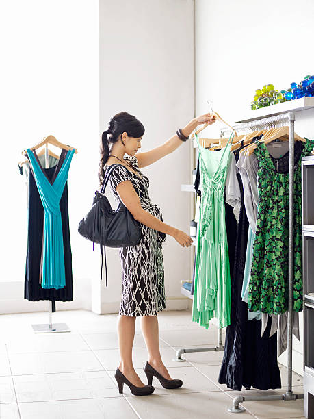 Young woman shopping in boutique stock photo