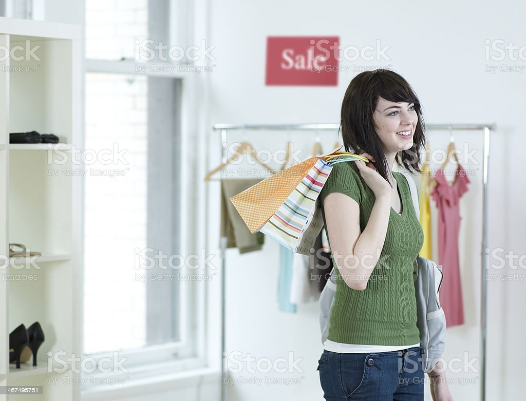 Young Woman Shopping in Clothes Store Young Woman Shopping in Clothes Store 18-19 Years Stock Photo