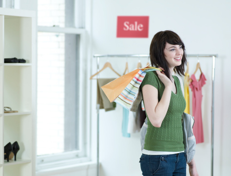 Young Woman Shopping In Clothes Store Stock Photo - Download Image Now