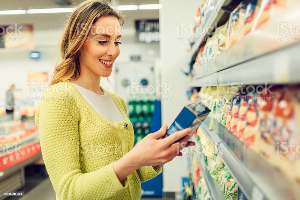 Young Woman Shopping In Her Local Supermarket. stock photo
