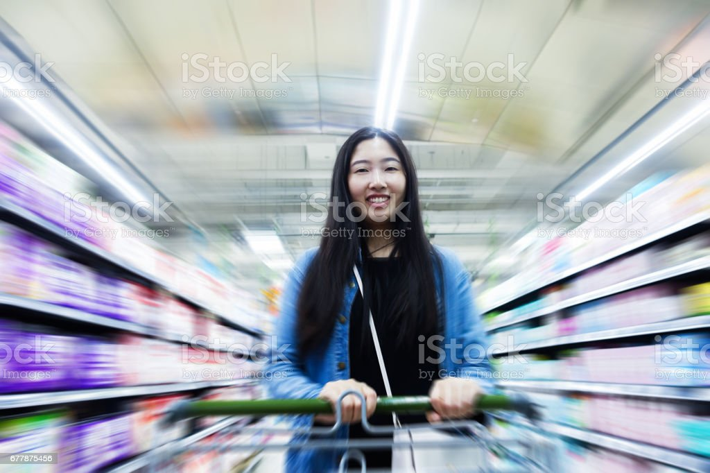 Young woman shopping in supermarket royalty-free stock photo