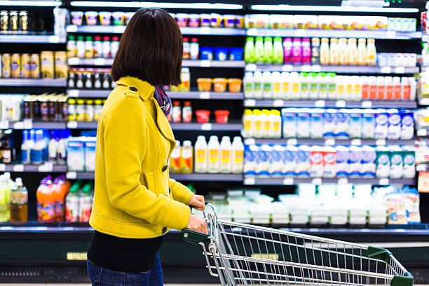 Young woman shopping in the supermarket stock photo