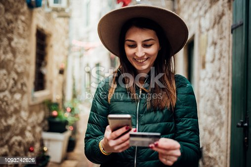 Woman using credit card and mobile phone