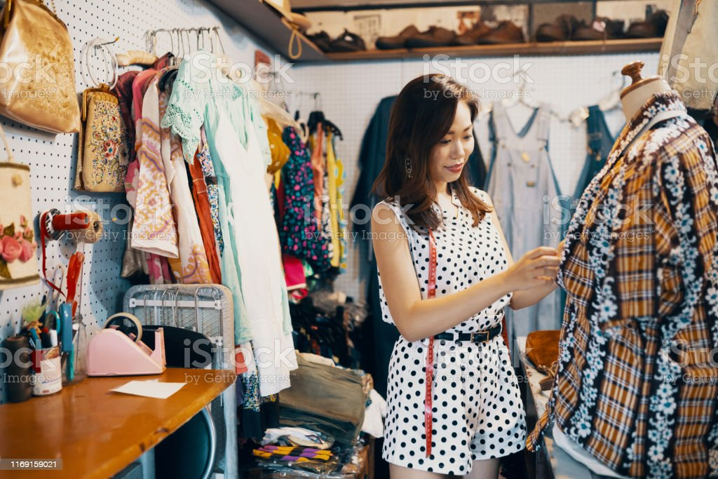 Young woman shopping something in a vintage clothing store Young woman shopping something in a vintage clothing store in Japan 20-29 Years Stock Photo