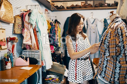 Young woman shopping something in a vintage clothing store in Japan