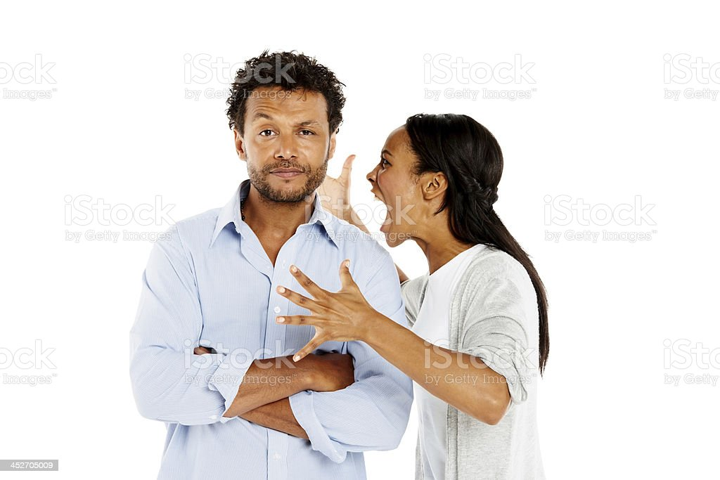 Young woman shouting at her boyfriend stock photo