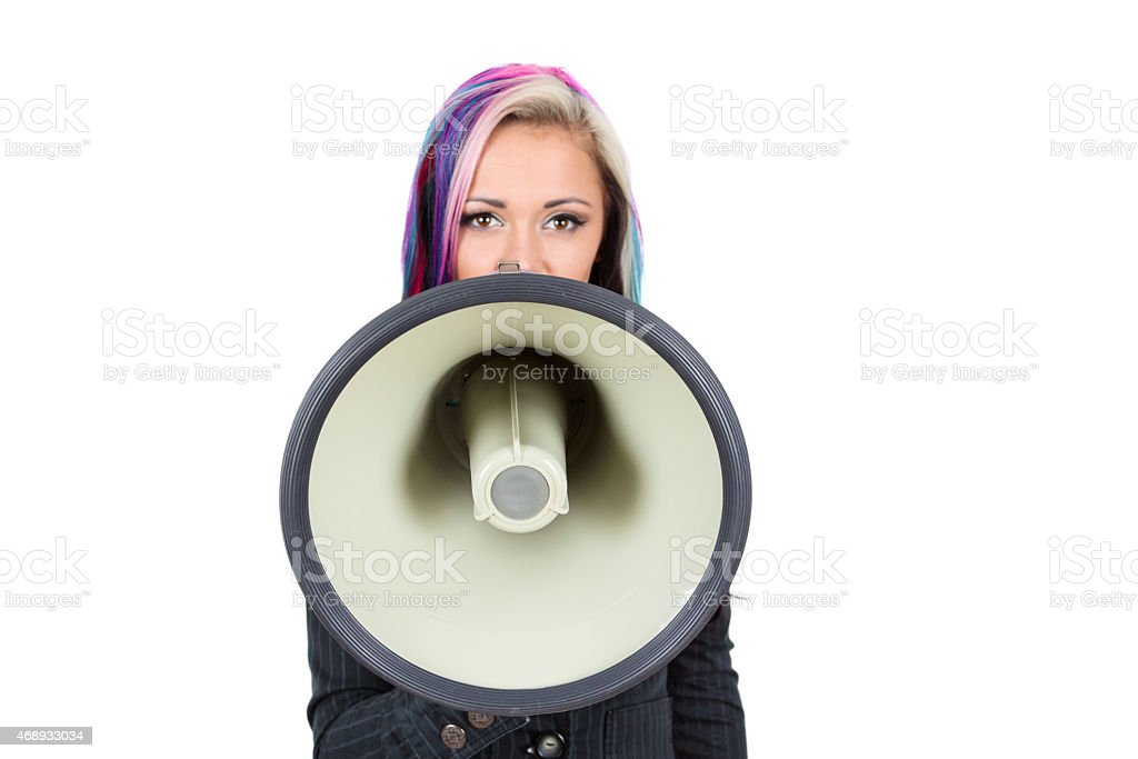 Young woman shouting in megaphone stock photo