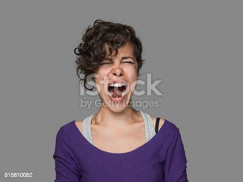 1138361116 istock photo Young woman shouting 515810052