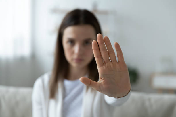 Young woman show stop gesture demonstrate protest stock photo