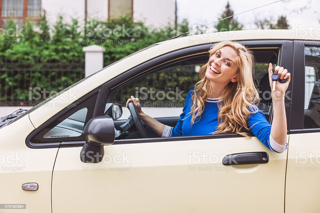 Young woman showing a car key stock photo