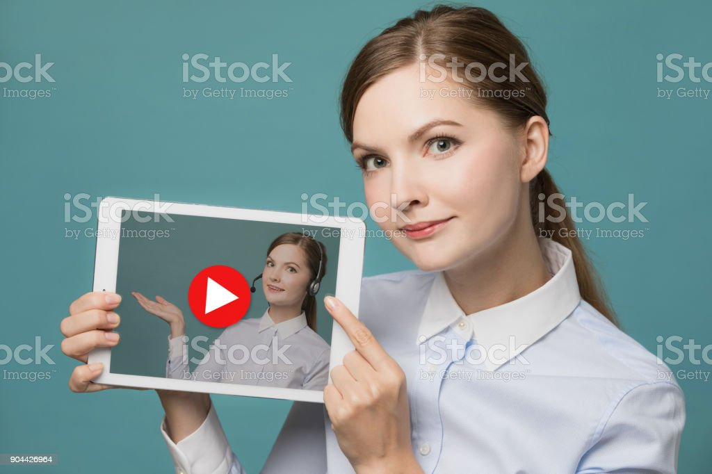 Young woman showing a movie. stock photo