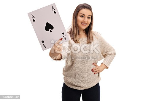 Young woman showing an ace of spades card isolated on white background