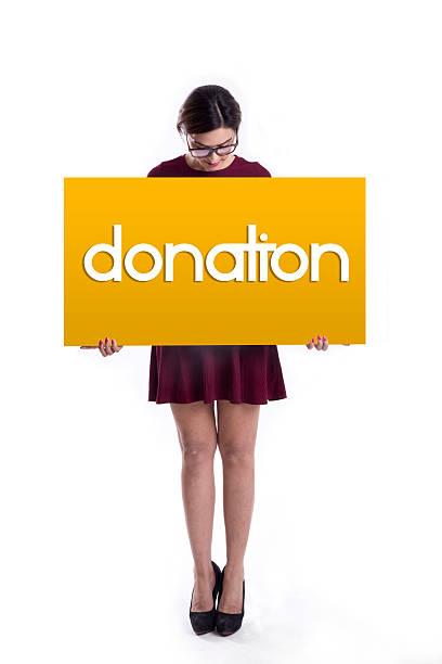 young woman showing donation on placard - spenden sammeln stock-fotos und bilder