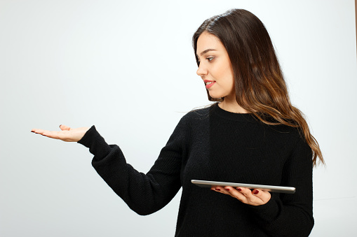 928855610 istock photo Young woman showing empty space with digital tablet 576548080
