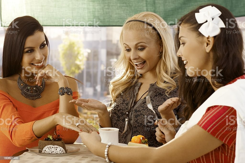 Young woman showing engagement ring to friends royalty-free stock photo