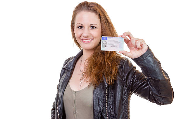 young woman showing her driver's license - cursed stock pictures, royalty-free photos & images