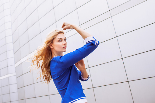 657442382 istock photo Young woman showing her strength 474419714