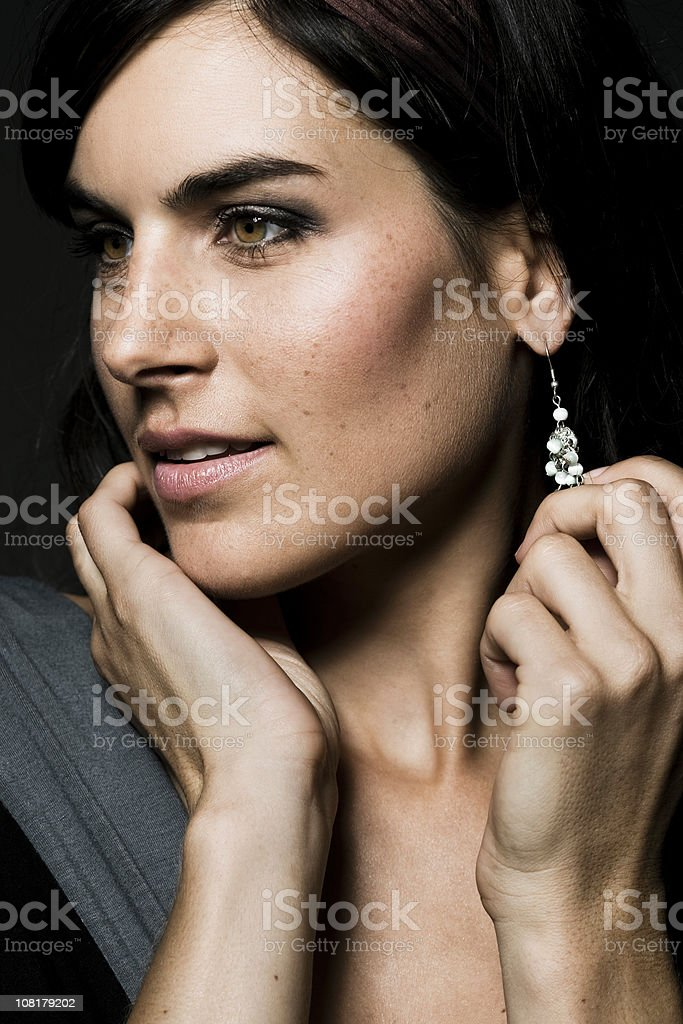 Young Woman Showing Off Earrings royalty-free stock photo