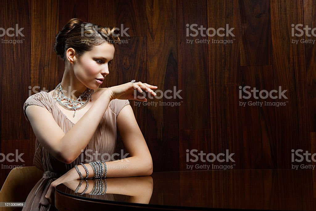 Young woman showing off ring stock photo