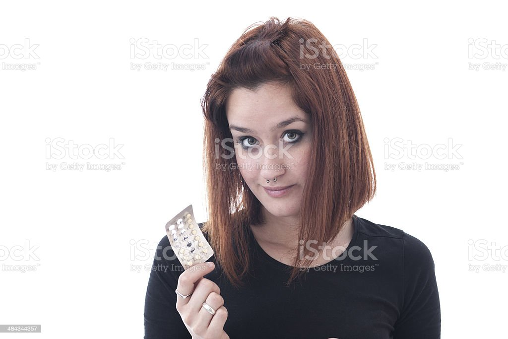 Young woman showing pack of pills stock photo