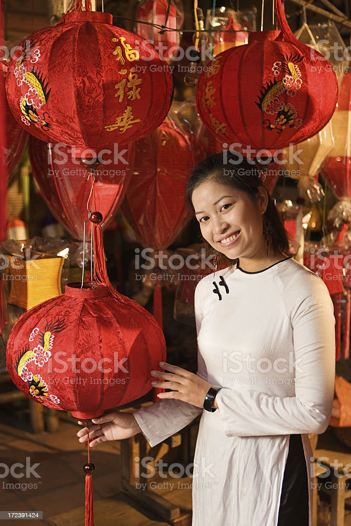 Young woman showing silk lanterns in Hoi An city, Vietnam royalty-free stock photo