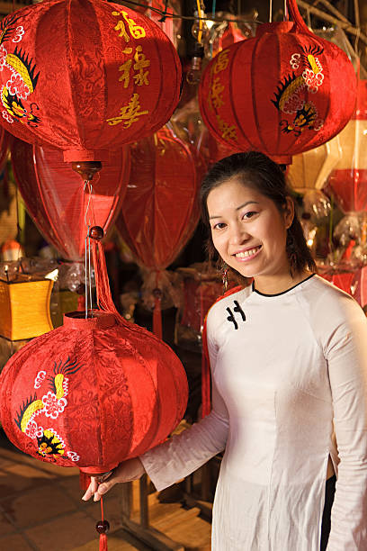 young woman showing silk lanterns in hoi an city, vietnam - ao dai stock photos and pictures