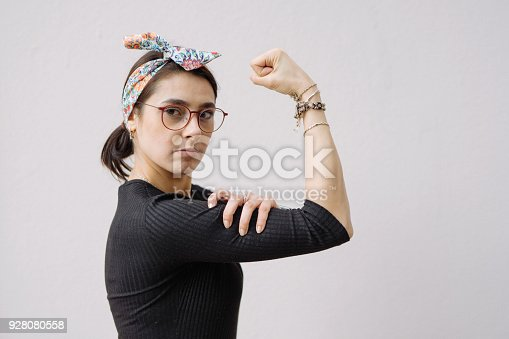 istock Young woman shows her strong arm 928080558