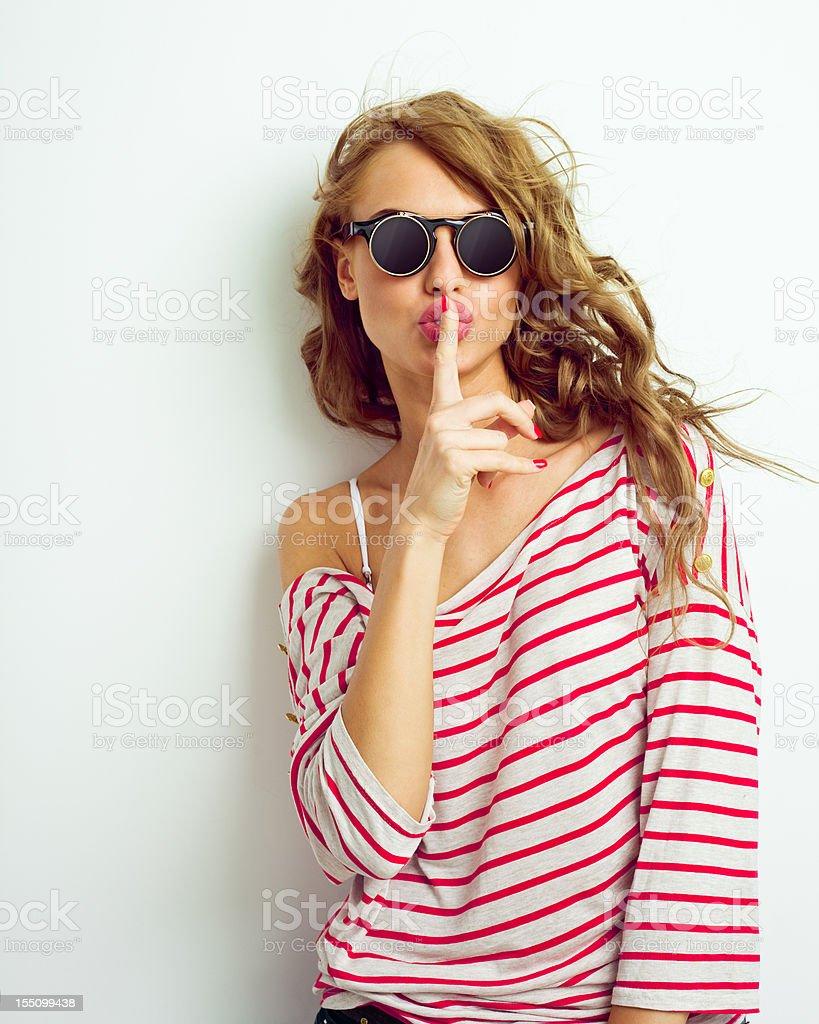Young woman shushing stock photo