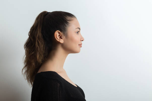 young woman side view - profile view stock photos and pictures