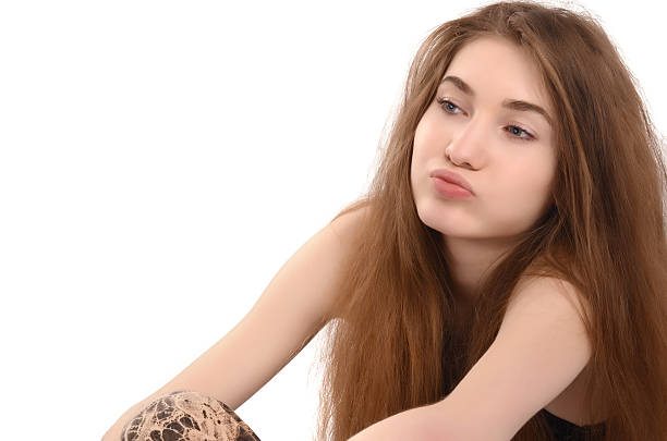 Young woman sighing. stock photo