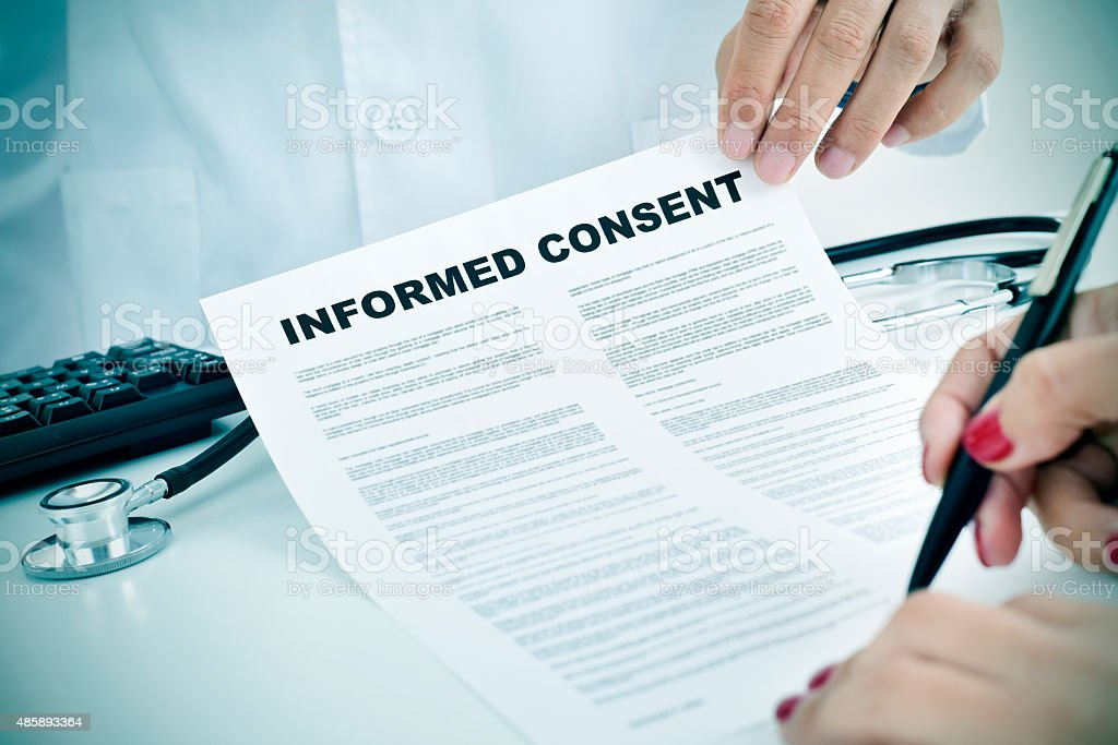 young woman signing an informed consent stock photo