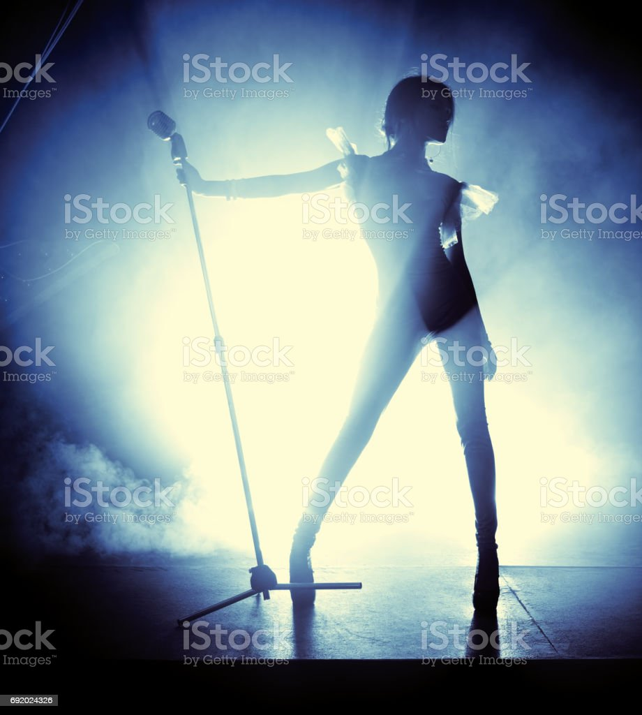 Young woman singer stock photo