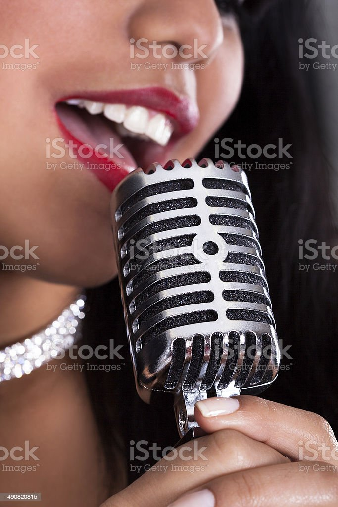 Young Woman Singing In Microphone - Royalty-free Adult Stock Photo