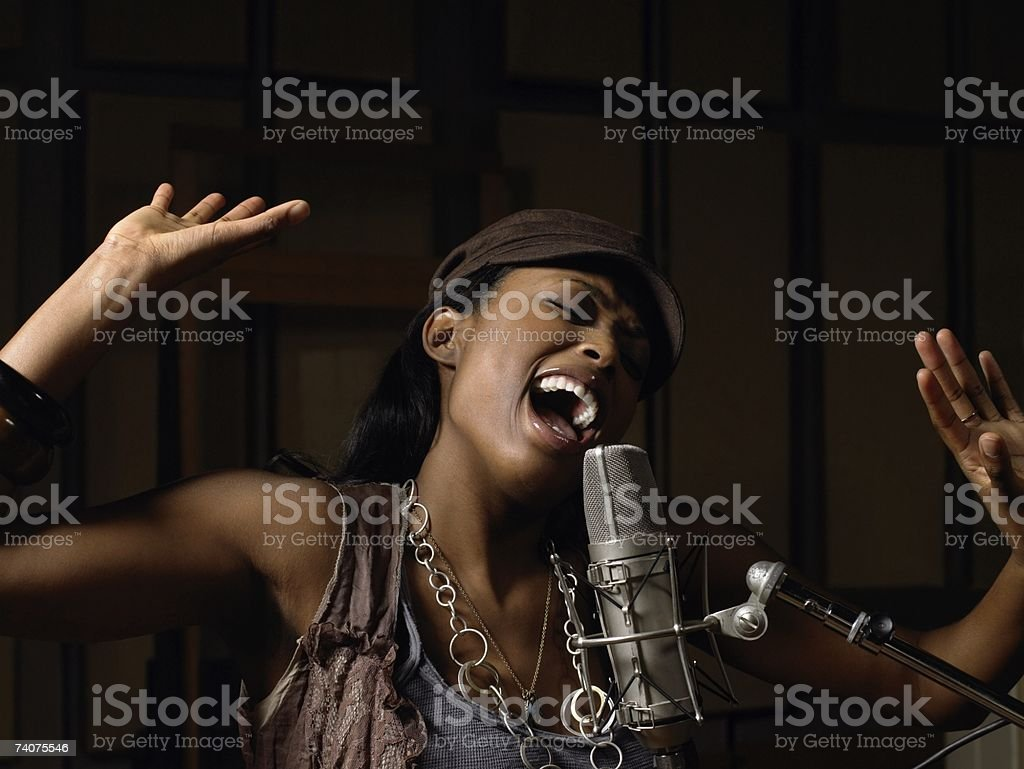 Young woman singing stock photo