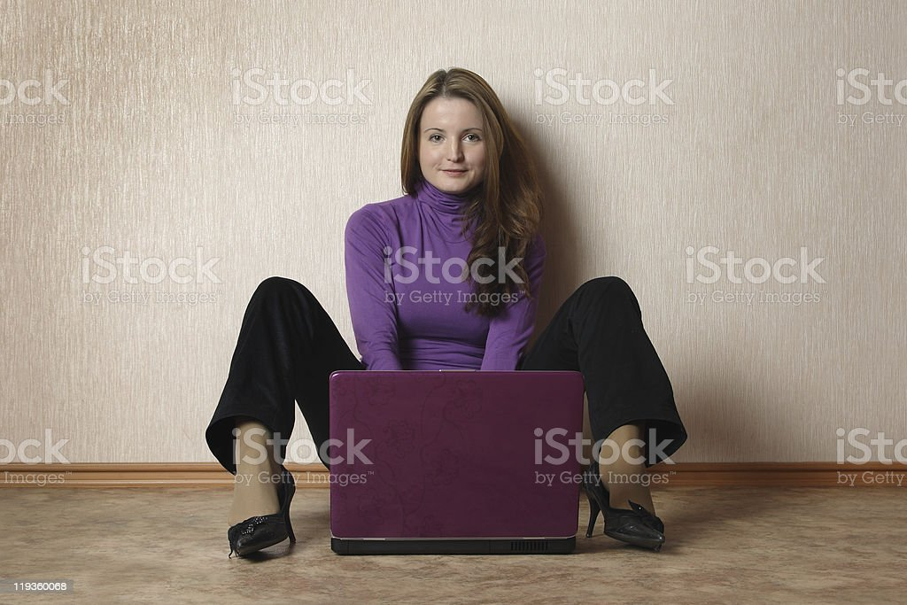 Young woman sit with notebook. stock photo