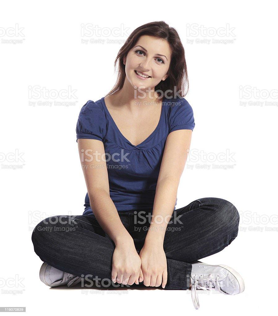 Young woman sitting cross-legged royalty-free stock photo