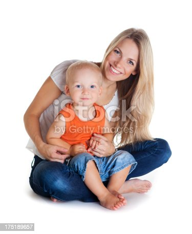 471164880 istock photo Young woman sitting down and toddler on her lap smiling 175189657