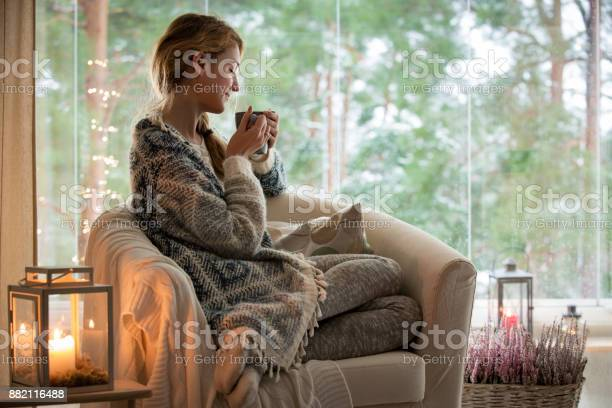 Young woman sitting home by the window picture id882116488?b=1&k=6&m=882116488&s=612x612&h=xnaf66vvfgze8 mn1spz jcocnr4t yrul6ci yfwgi=