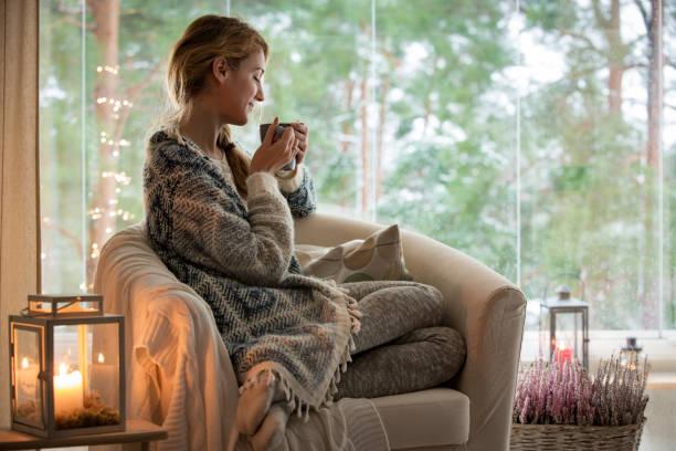 Young woman sitting home by the window picture id882116488?b=1&k=6&m=882116488&s=612x612&w=0&h=roqucvxd0ltp3xfahz ohhhqoyqsdd9r m7vbuzxrqa=