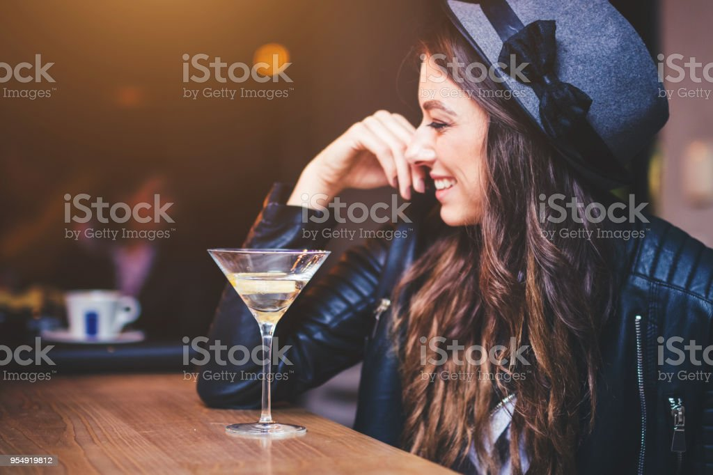 Young woman sitting in a bar stock photo