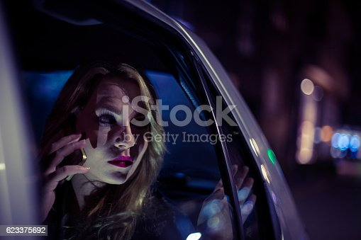527894422 istock photo Young woman sitting in a car and using smart phone 623375692