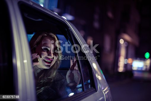 527894422 istock photo Young woman sitting in a car and using smart phone 623375748