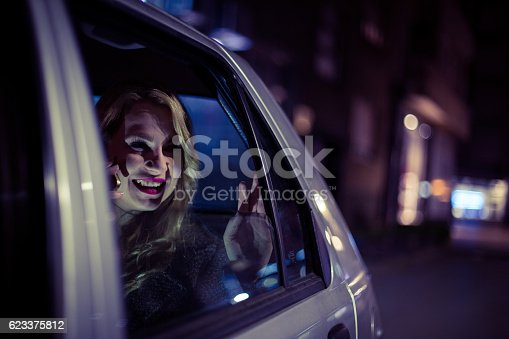 527894422 istock photo Young woman sitting in a car and using smart phone 623375812