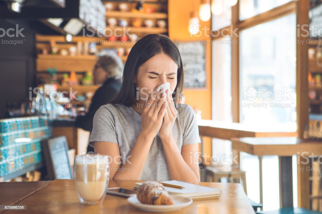 Young woman sitting in a coffee shop leisure stock photo
