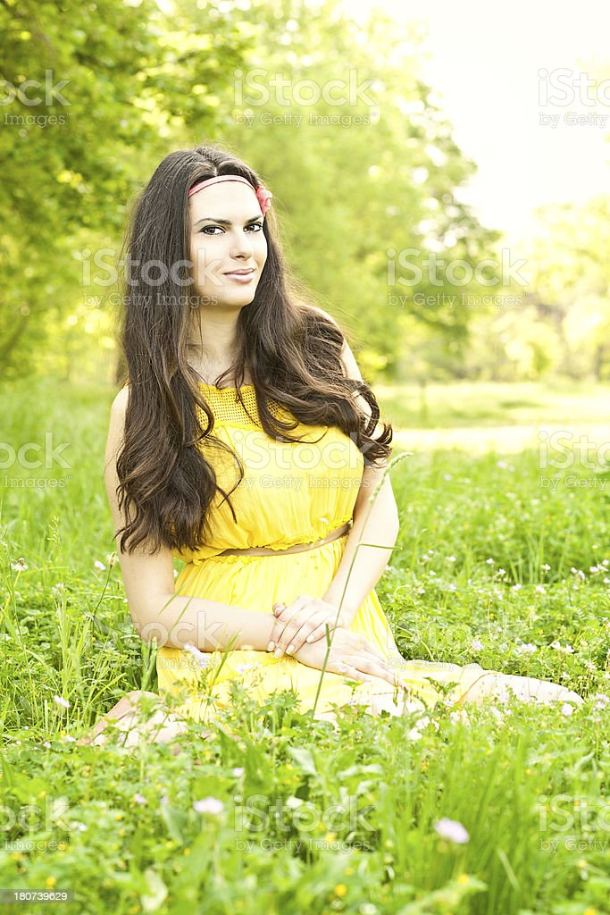 Young woman sitting in a park royalty-free stock photo