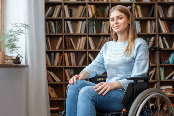 Young woman sitting in a wheelchair disability concept stock photo