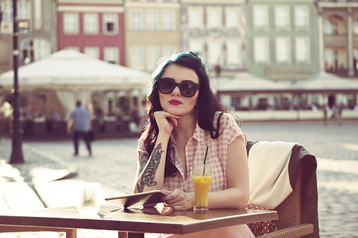 Young Woman Sitting In An Outdoor Restaurant Stock Photo - Download Image Now